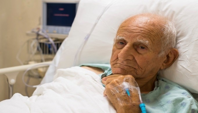 Elderly man in hospital bed