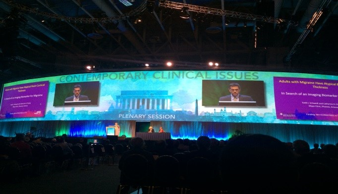 Todd Schwedt, MD, presenting his findings in a plenary session at the AAN 2015 Annual Meeting.