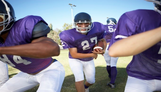 White Matter Structure Influenced by Football Career Length, Position