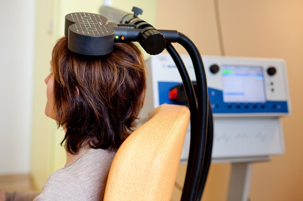 Therapeutic seizures are induced through the use of high-frequency, repetitive transcranial magnetic stimulation.