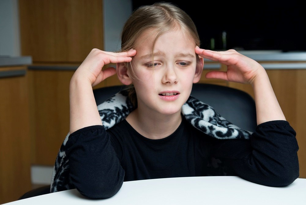 Over-the-counter pain reliever was typically given to children for headache, most often acetaminophen and/or ibuprofen.