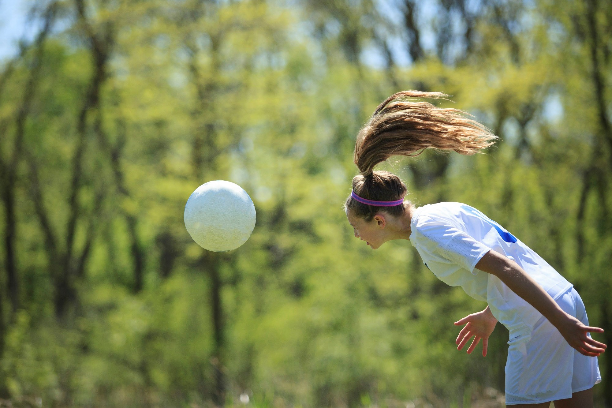 Female soccer players exhibit more widespread evidence of microstructural white matter alteration than males, despite having similar exposure to heading.